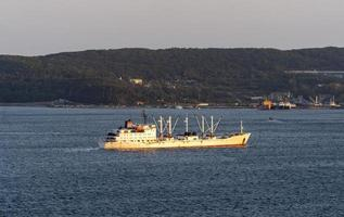 Seascape with a view of a fishing ship photo