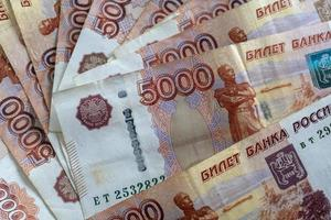 Background with Russian money in the form of five thousand rubles photo