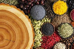 Spices around wooden texture with empty space photo