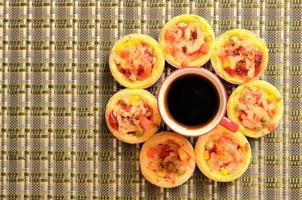 Egg tart pizza circle and coffee cup concept photo