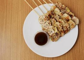 Grilled banana with sweet taste sauce on above views photo