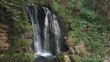 Alpine valley springs waterfall in Italy video
