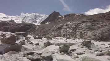 Large stones emerge from an alpine glacier video