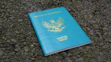 Republic of Indonesia Passport book, isolated on asphalt ground photo