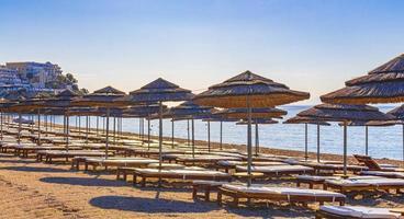 Sun loungers and parasols on the beach Kos island Greece. photo