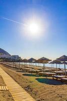Chemtrail cross the sun above the beach Kos island Greece. photo