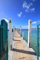 Pier at waikiki beach honolulu hawaii photo