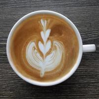 Top view of a mug of latte art coffee photo