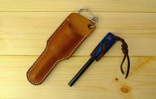 Magnesium flint fire steel and leather case is trekking equipment photo