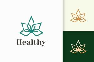 Beauty or health logo in flower shape fit for wellness or clinic vector