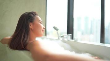 Young asian woman taking a bath video