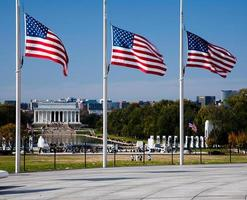 American flags at half staff photo