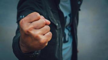 A man fists clenched in anger photo