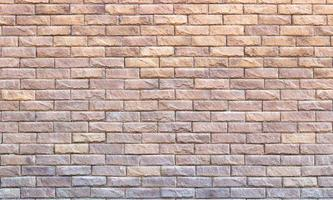 Background of yellow facing bricks. Bricks relief close up photo