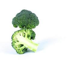 Broccoli vegetale sliced on white backgrounds photo