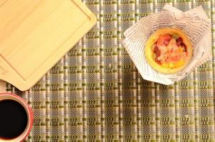 Delicious homemade egg tart pizza and hot coffee cup backgrounds photo