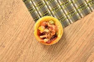Tasty egg tart pizza homemade on wooden backgrounds above photo
