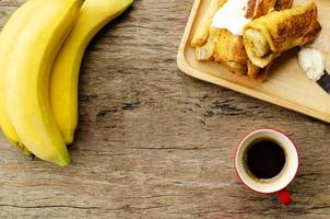 Banana french toast and Black coffee red cup, Place for your text photo