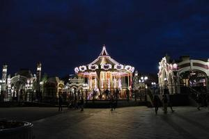 Historical Carousel during night on a amusement fair in Moscow, Russia photo