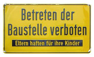 German sign isolated over white. Trespassing forbidden. photo