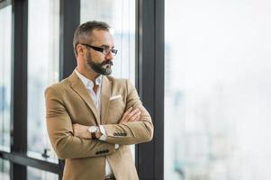 Young handsome business bearded man photo