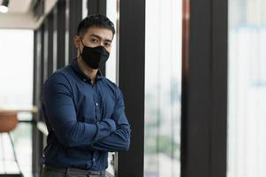Business asian man wearing protection face mask photo