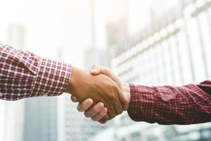 Two people shaking hand photo