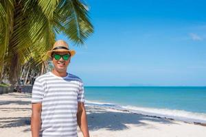 Happy Young man on the tropical beach photo