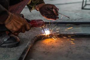 Worker welding the steel photo