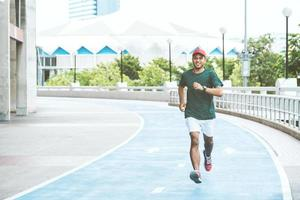 Young asian man running concept photo