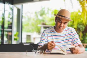 Young asian man reading a book study Concept. photo