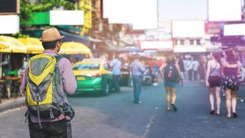 Bangkok, Thailand, 2021 - Traveling man walking on Khaosan Road photo