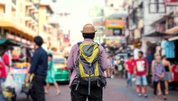 Young Asian traveling man walking in Khaosan Road photo