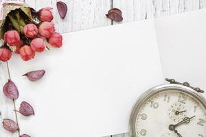 Paper with flowers and a clock photo