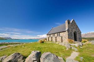 Rustic Church by an Alpine Lake photo