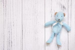 Blue bear on white wood photo