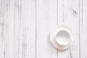 Coffee cup on white wood photo