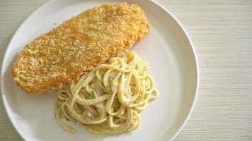 fettuccine spaghetti pasta white cream sauce with fried fish video