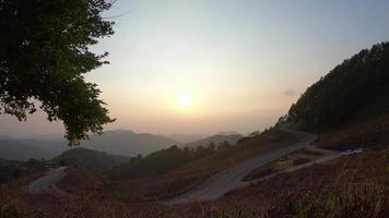 sunset with layer mountain and road in Thailand video