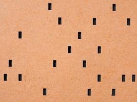 Orange punched card for programming photo
