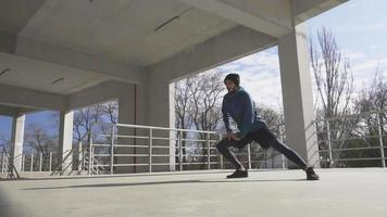 Young male training in sunny autumn day, urban background video