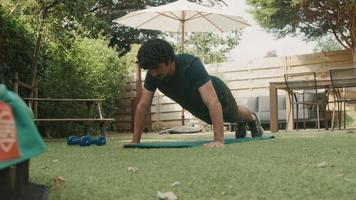 Man doing push ups in garden video