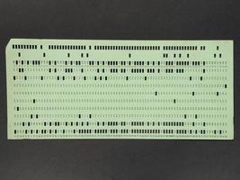 Green punched card for programming photo