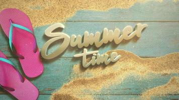 Animated text Summer Time and closeup sandy beach with sandal on wood video