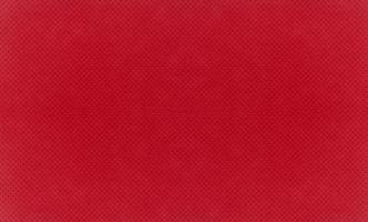 fondo de textura de tela de terciopelo rojo foto