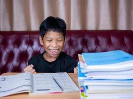 The boy was very happy to finish his homework. photo