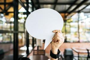 holding speech bubble oval in cafe photo