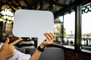 woman holding speech bubble rectangle with conners rounded photo