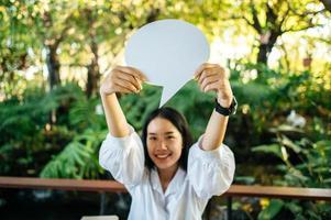 woman holding speech bubble oval photo