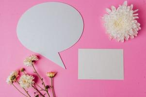 speech bubble oval, flower and clear card with pink background photo